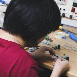 Person working on electronics